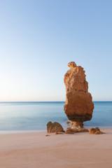 Portugal, Algarve, Praia da Marinha, Stack rock at sandy beach