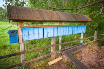 Old blue mailboxes in a row