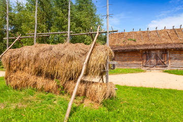 Outdoor hay drying construction near old barn