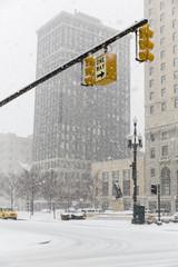 USA, Michigan, Detroit, Stoplights over crossroad in snowfall