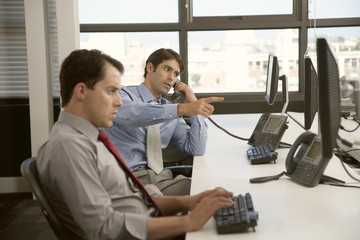 Two men working in office