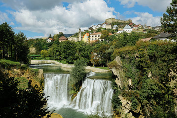 Bosnia and Herzegovina, Jajce, Town on hill, waterfall in foreground