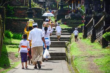 Balinese people walk in traditional dress in Pura Besakih