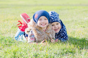 happy two little girls on the grass