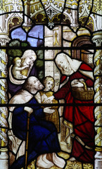 Feeding the poor (stained glass window)