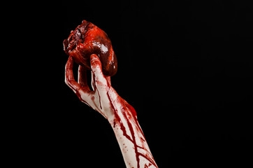 terrible bloody hand hold torn bleeding human heart isolated