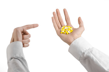 doctor's hand holding a yellow capsule for health isolated