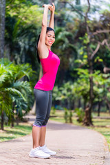 Asian Woman stretching in fitness exercise