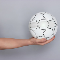 male hand holding ball