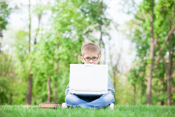 boy with a books and laptop computer