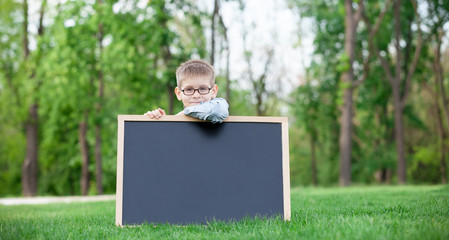 young boy with a blackboard