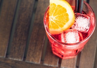 top of view of spritz aperitif aperol cocktail with orange
