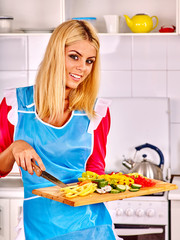 Woman cooking breakfast at kitchen.