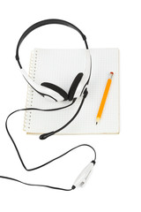 Headphones and notepad