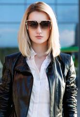 fashion portrait of stylish beautiful woman in leather jacket an