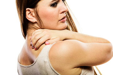Woman scratching her back isolated