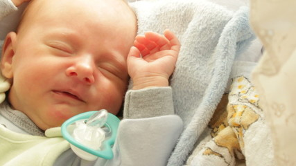 Closeup little newborn baby girl sleeping in bed. Full HD