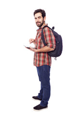 Full body of a smiling student holding a tablet pc, isolated on