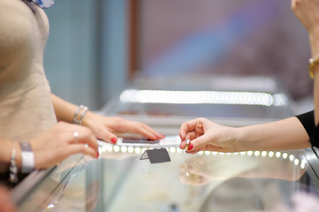 Woman trying rings at a jeweler