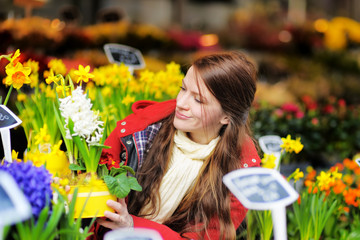 Young woman selecting fresh flowers