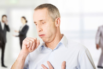 Mature man coughing.