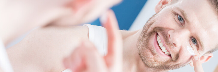 Man applying anti-aging cream