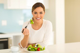Fototapety healthy young woman eating salad