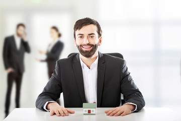 Businessman with small house.