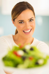 woman with plate of vegetable salad