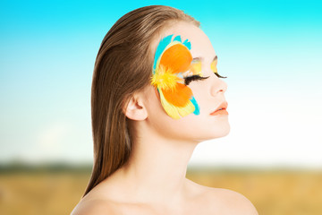 Beautiful model with abstract make up.