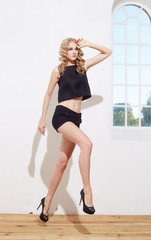 Blond female in black clothes