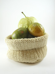 Green orange and guava fruit  in a sack