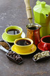 green, black coffee beans and different utensils