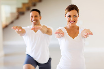 young woman exercising with boyfriend