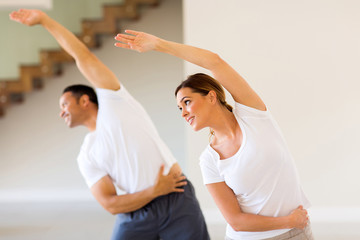 woman exercising with husband