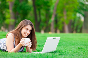 girl with laptop computer and cup