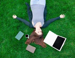 student girl with laptop computer and books