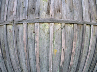 Fragment of an old wooden fence from boards