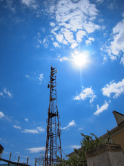 Tower of cellular communication against the blue sky