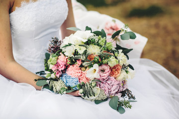 unusual wedding bouquet with different flowers