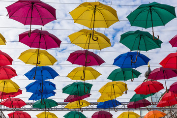 Street decoration, lots of colorful umbrellas in the air