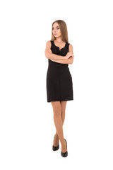 Confident young beautiful businesswoman looking awaywhile standi