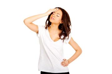 Woman with a headache holding head.