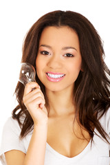 Young woman with light bulb.