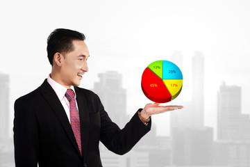Business Man Showing Digital Chart