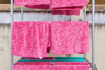 pink towel on clothesline in sunny day