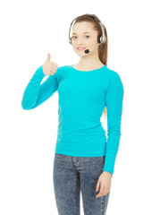 Call center woman operator with thumbs up.