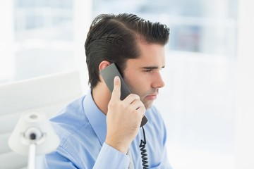 Thoughtful businessman having phone call