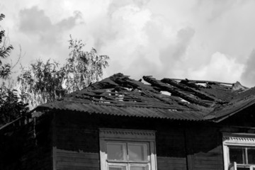 Burnt roof of house on summer day
