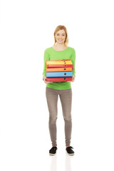 Young woman with heavy binders.